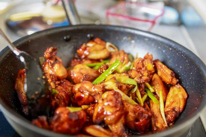 chicken wings in frying pan