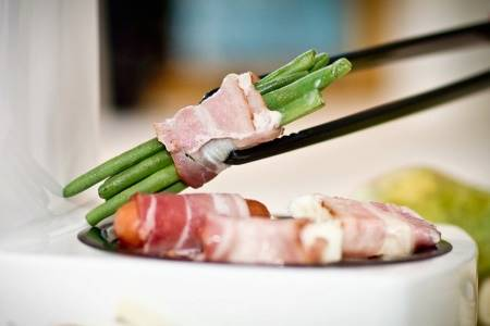 Cooking Vegetables Wrapped In Bacon