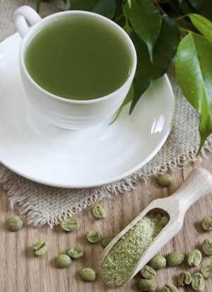 Cup Of Green Coffee With Green Coffee Beans