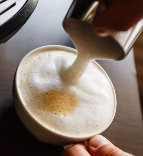 pouring frothed milk